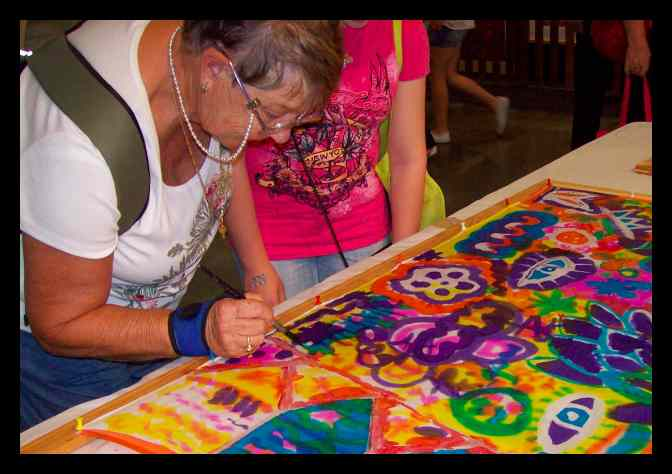 Learning how to paint on silk - from young children to our wise elders, they all had fun